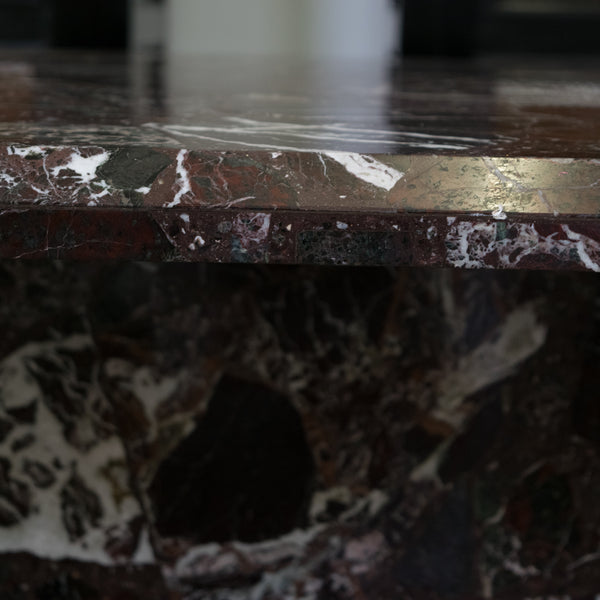 A Rosso Levanto Marble Dining Table