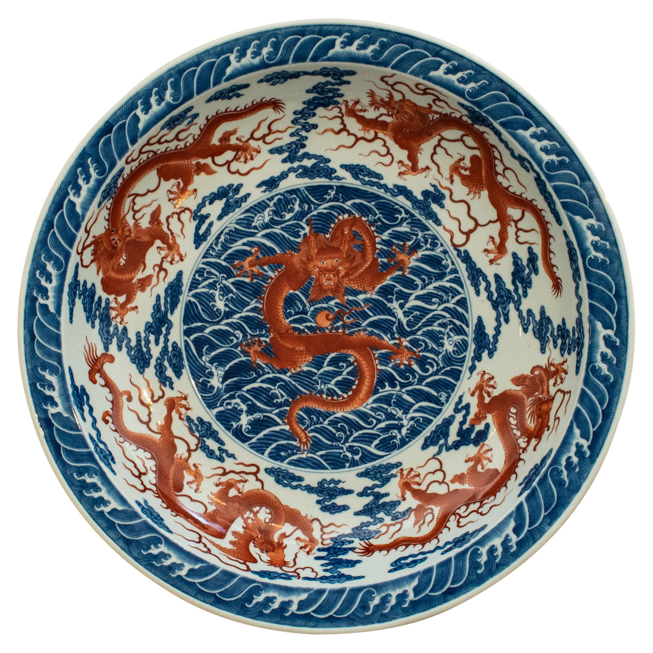 "A Chinese Blue and Iron Red ""Nine Dragon"" Porcelain Charger"