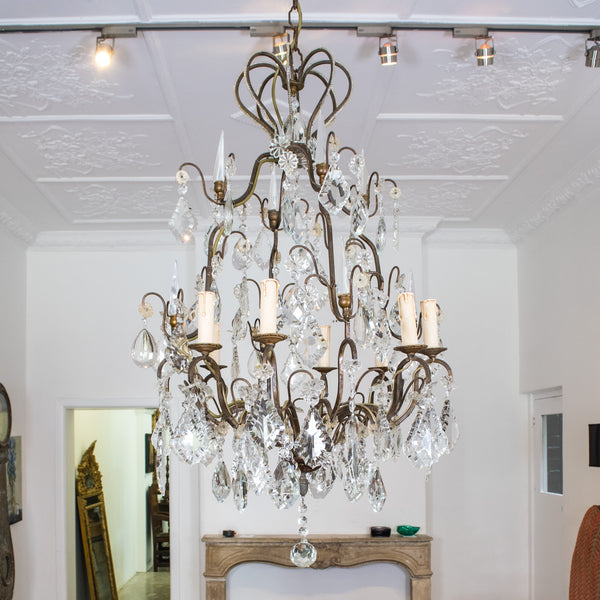 A Louis XV style Bronze and Crystal 8 Light Chandelier