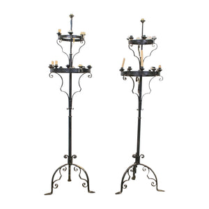 A Pair of Black Painted Wrought Iron Candle Sticks