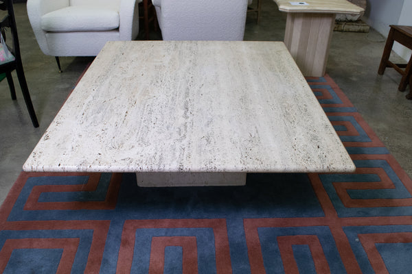 A large Travertine Coffee Table. Cube Base