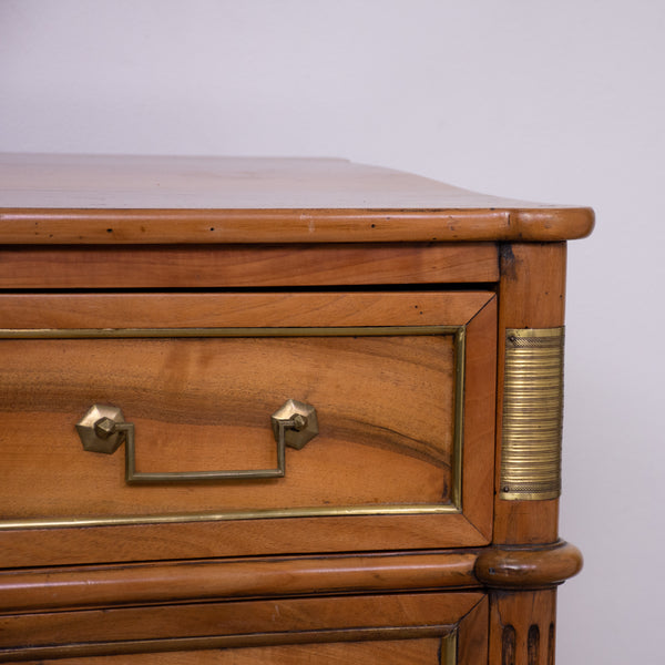 A Louis XVI Style Blonde Walnut Commode