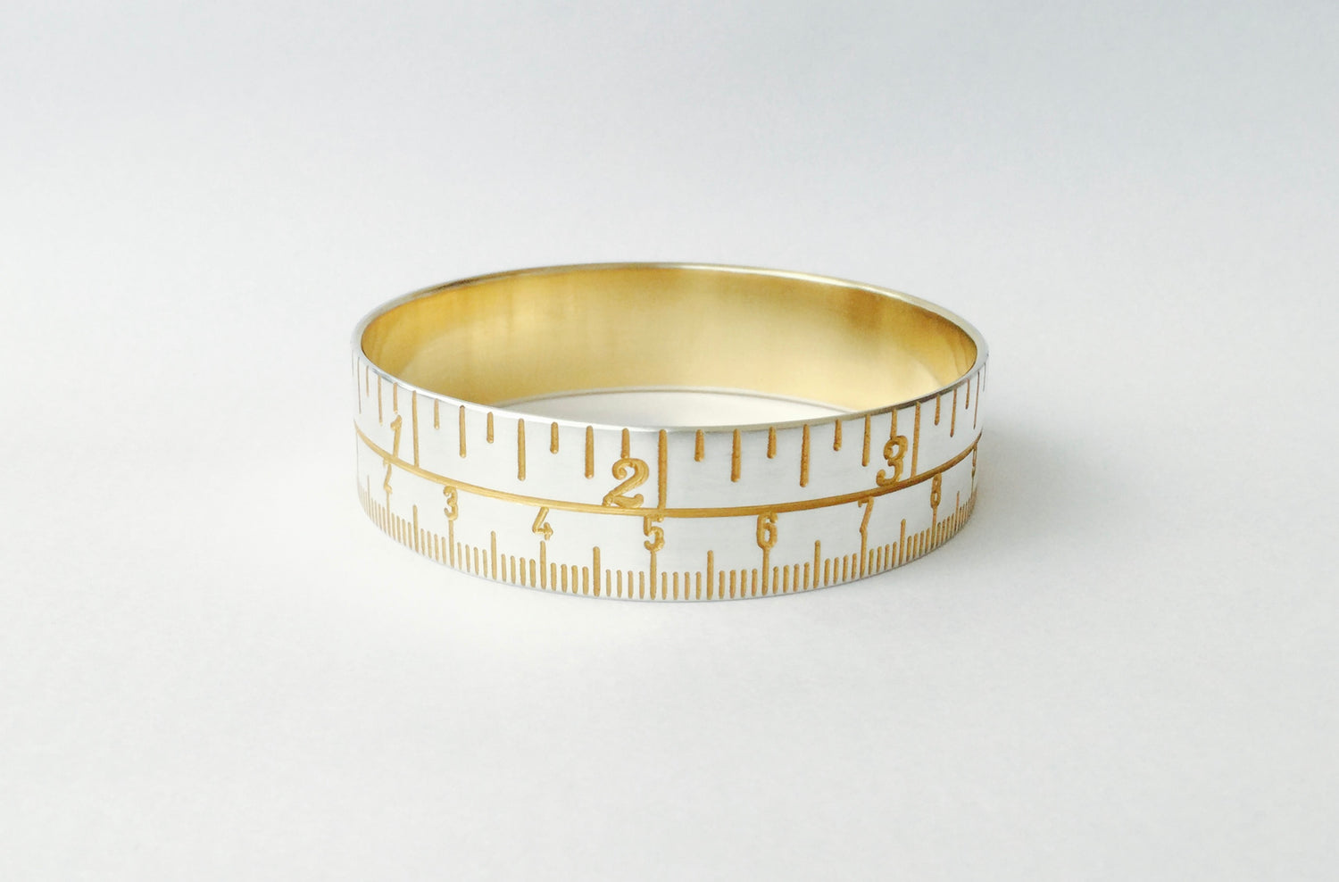 Tape Measure Bangle - gold/silver