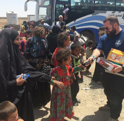 Bryan Myers handing out candy in recently liberated area of Mosul. - MiseryIncorporated