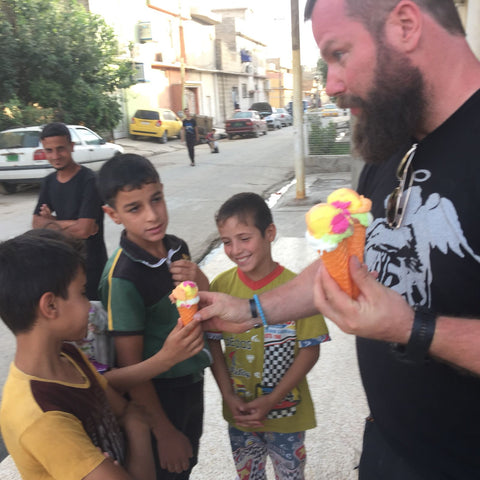 Bryan Myers handing out ice cream to recently liberated area of Mosul - MiseryIncorporated