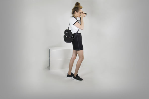 Black WAYKS ONE camera bag on female model taking photos