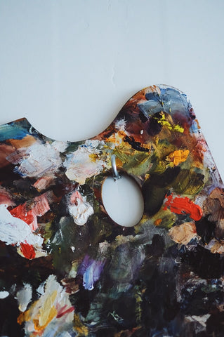 Art palette with colourful dried paint
