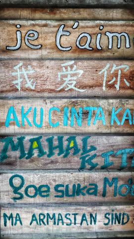 languages painted on wooden panels