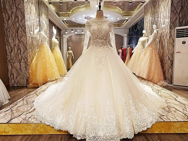 ... 2018 Sexy Long Sleeves Pearls Lace Wedding Dresses Light Champagne Luxury  Bridal Princess Gowns Vestido De ... 49c71abe36af