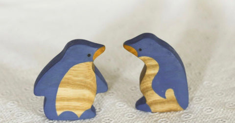 wooden penguins - available