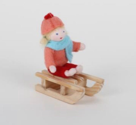 girl on sledge - orange - available