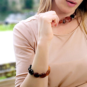 Model wearing a bold, yet elegant handmade bracelet that shows off beautifully the natural markings of the Brazilian Agate stone. (1442220736624)