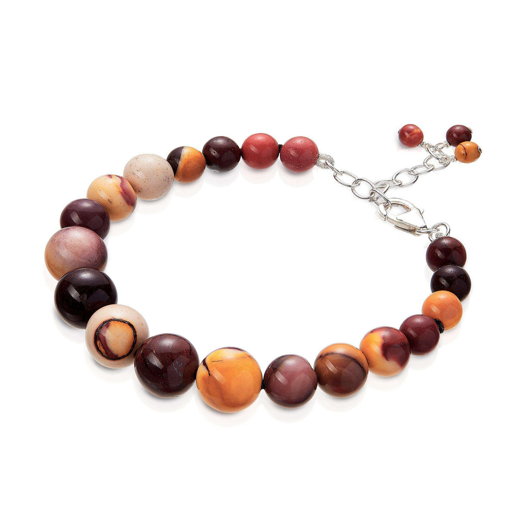A semi-precious natural stone bracelet of Australian Mookaite gemstone, featuring a larger central stone which graduate down to smaller beads at both ends.