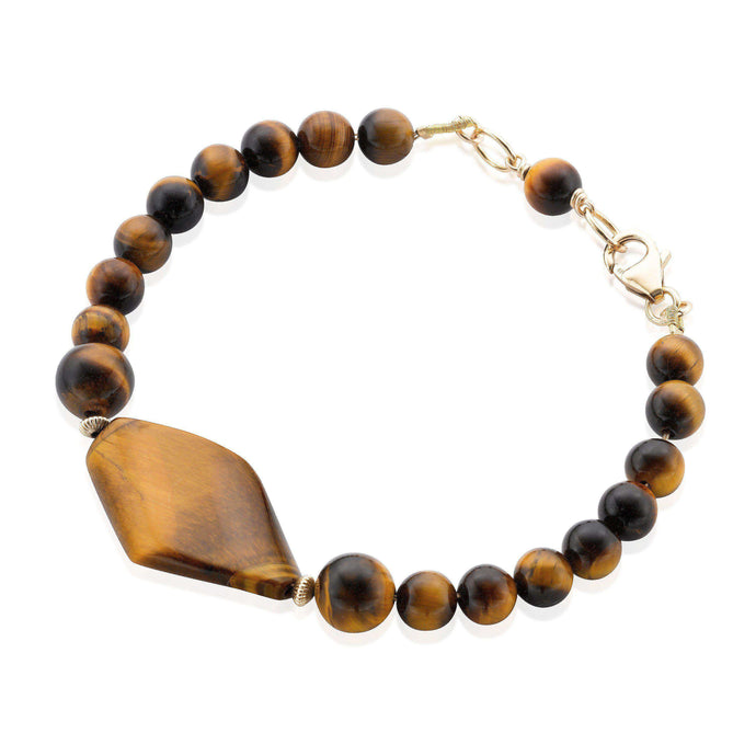 Modern and sleek Tiger's Eye gemstone bracelet accented with Gold filled rondelle beads and clasp. (1443245588592)