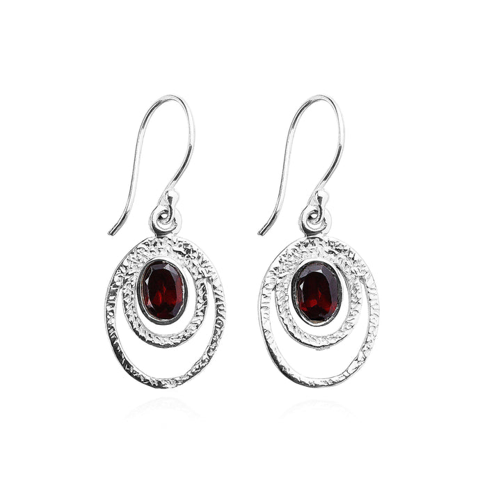 Elegant and simple, these 925 Sterling Silver drop earrings showcase an oval Garnet gemstone, perfectly framed by the textured double hoop silver design.  (578097053707)