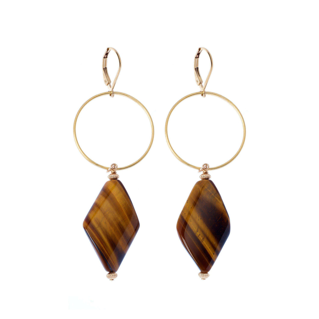 These unique earrings boast a gorgeous Gold filled hoop design, holding elegantly a shimmery high graded Tiger's eye gemstone