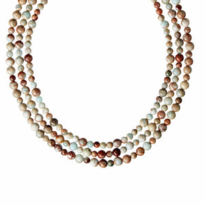 A three row statement necklace of high quality Impression Jasper gemstones and 925 Sterling Silver bar clasp.