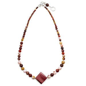 Elegant and colourful one row necklace made of Mookaite Jasper gemstones, featuring a diamond shaped larger central stone as a main feature, which graduates down to smaller round beads at both ends. (2022101778518)