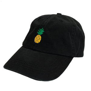 Front view of Jimmy Oakes' pineapple design embroidered using yellow and green thread to a black Alternative Apparel AH70 dad hat