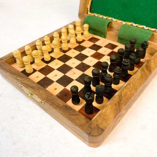 Open box showing chess board and pieces ready to play.