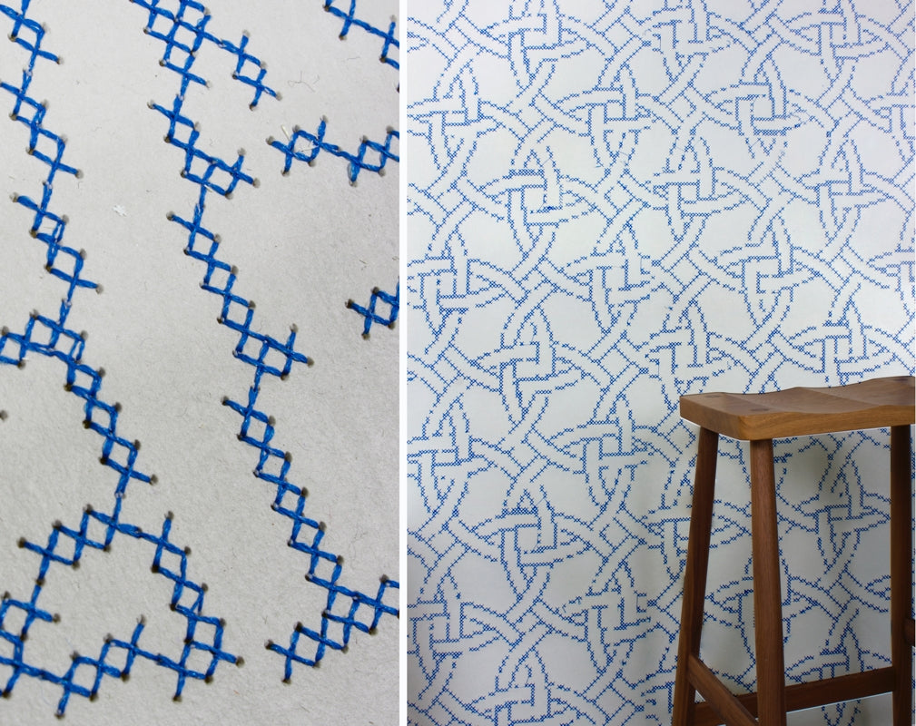 A detail and lifestyle image show the intricate pattern of New Cross Embroidered wallpaper by CUSTHOM