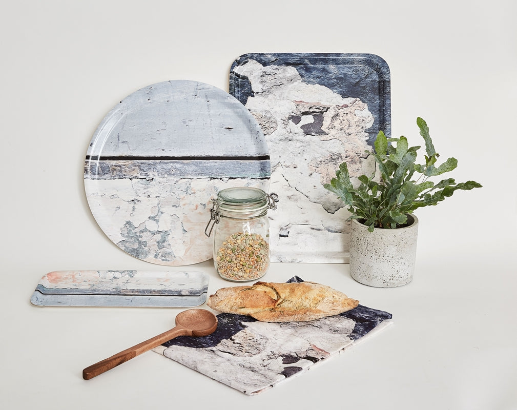 A selection of kitchen trays and a tea towel from Ruth Holly's Aspect collection