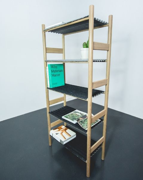 Benjamin Stanton's shelving is made from an oak frame with corrugated denim shelves