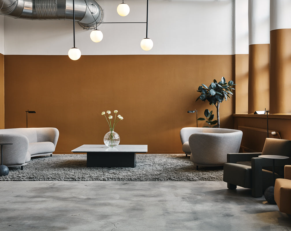 Bob-The-Robot-living-area-concrete-floor-orange-warehouse-home