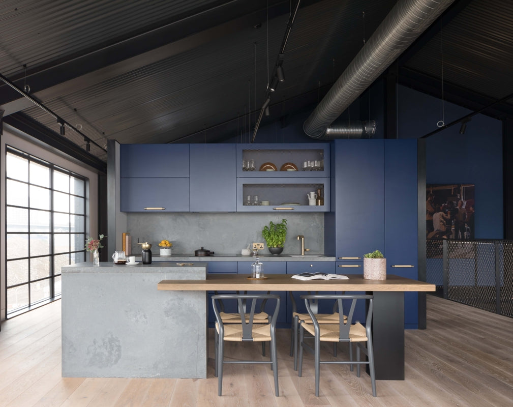 Caesarstone's 4033 Rugged Concrete quartz surfaces feature in the kitchen of an industrial home