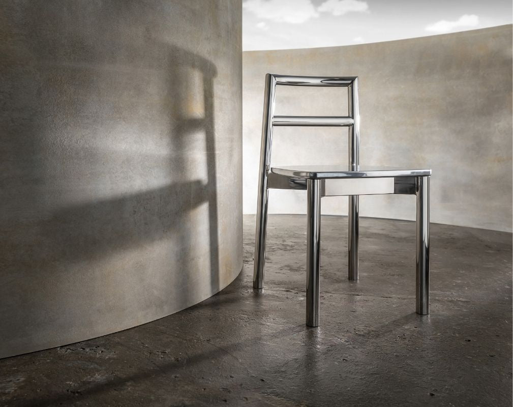 Silver chair by Didier against a concrete background