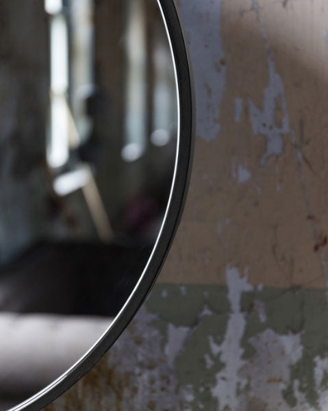 Dutchbone Attractif Industrial Style Mirror Close Up against a distressed wall