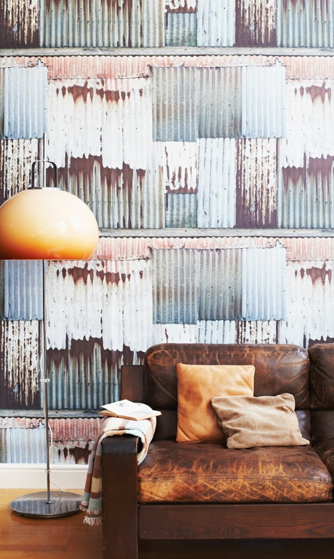 Ella Doran's Corrugated Chic wallpaper design with a brown leather sofa. Photo by Rita Platts