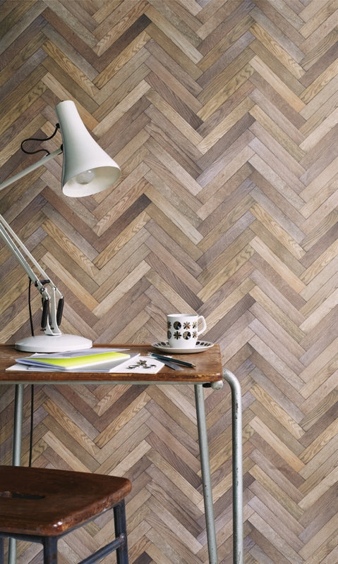 Ella Doran's Parquet wallpaper with desk, stool and table lamp set up