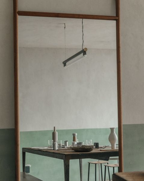Frama Eiffel Pendant reflected in mirron in Frama Studio Apartment Mexico