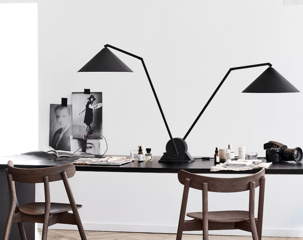 Gear double table lamp by Northern on a desk