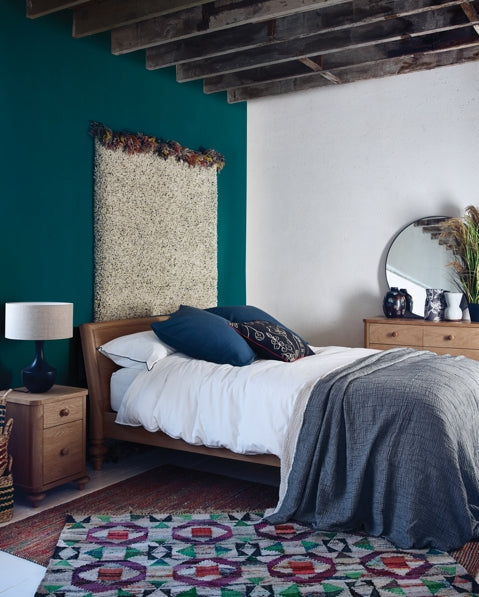 Habitat's Sabine bed and Flounce rug from the AW18 collection feature in a rustic chic bedroom