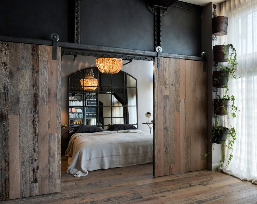 Bedroom behind industrial sliding doors featuring Havwoods Weathered Wood Rustic Surfaces
