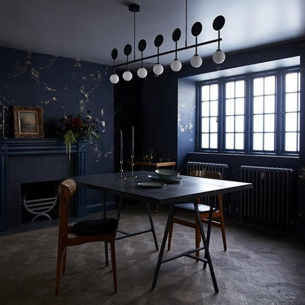 Igneous wallpaper in Navy by CUSTHOM featured in an industrial contemporary dining room