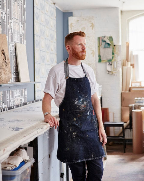 Independent wallpaper, textile and surface designer Daniel Heath stood in his London studio