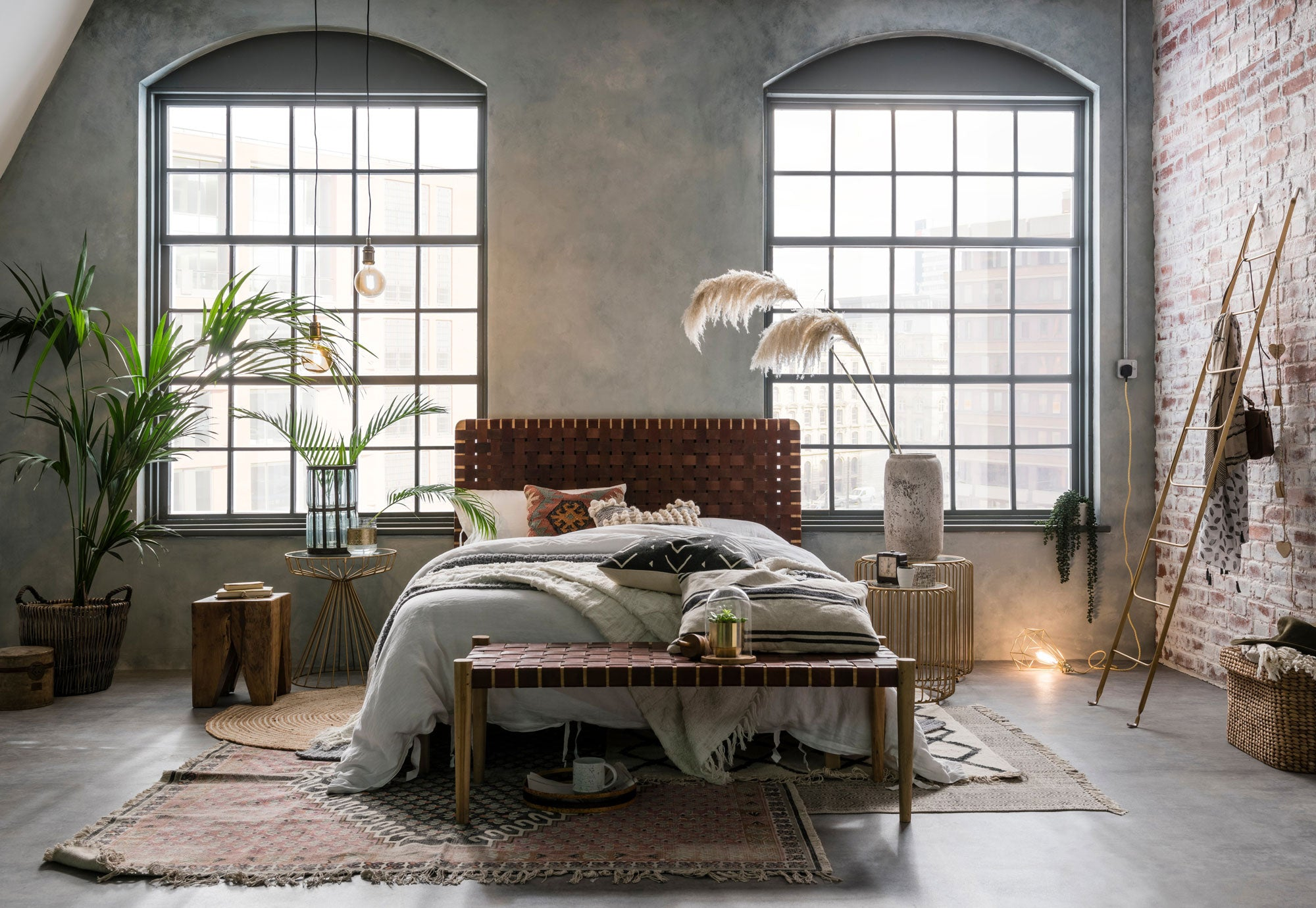 Industrial style bedroom featuring woven leather furniture and metallic furniture pieces from Cuckooland