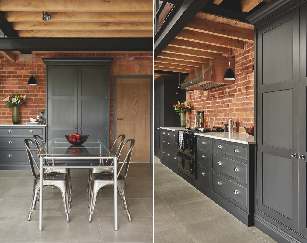Industrial Shaker style kitchen in charcoal grey. The cabinetry contrasts with the exposed brick wall. Kitchen by Tom Howley.