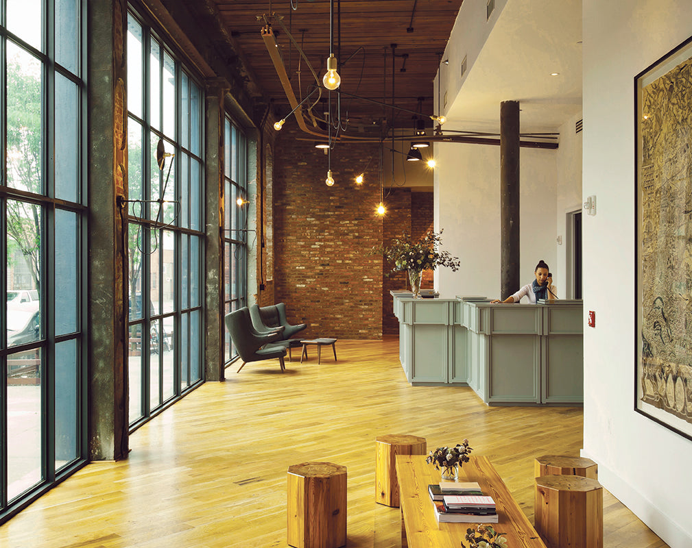 industrial interior scheme of the lobby at the wythe hotel brooklyn new york