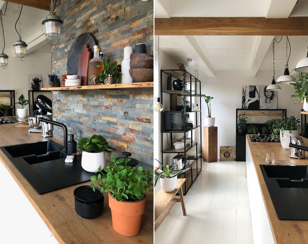 Jellina Detmar's industrial style farmhouse. Natural wood and plants in the kitchen help to soften the strong monochrome colour palette.