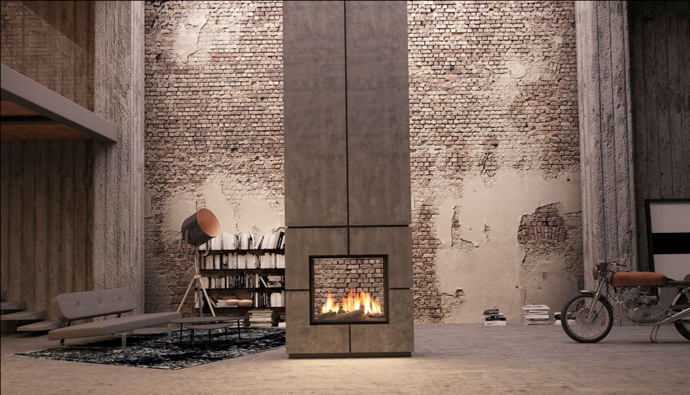A contemporary fire from Living Fire set in an industrial building with exposed brick and concrete pillars