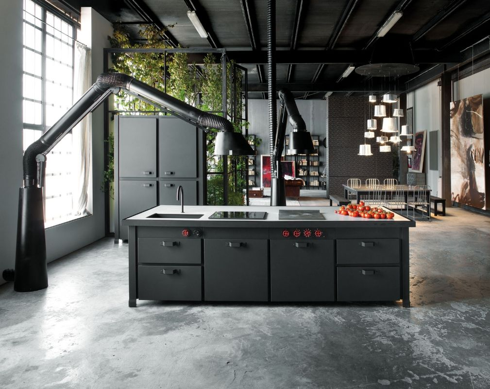 Minacciolo Mina Black Kitchen in an industrial loft in Milan with enormous freestanding cooker hoods