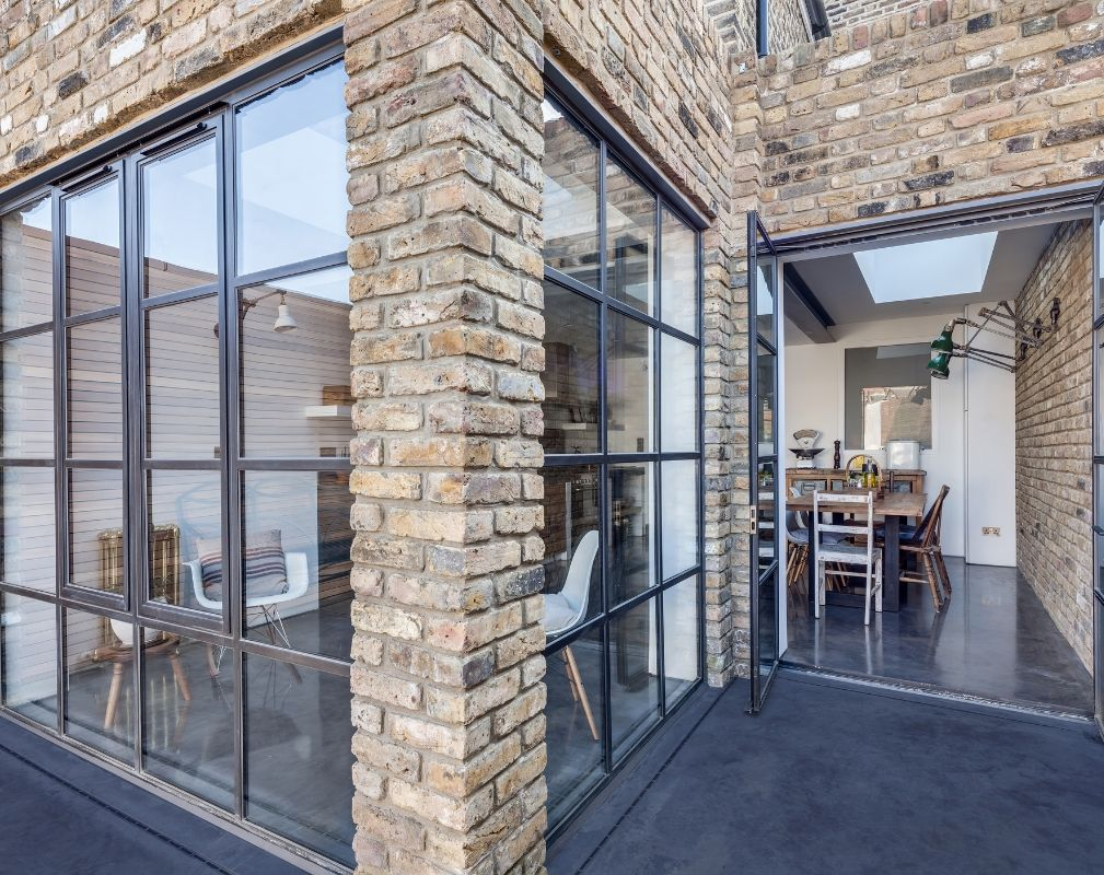 Large Crittall style windows and doors are a real style statement in the extension of this period property renovated by Paper House Project