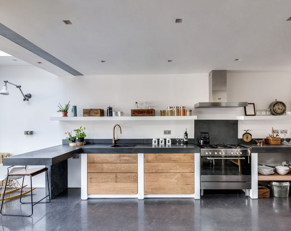 The open plan kitchen of this industrial style renovation by the Paper House Project