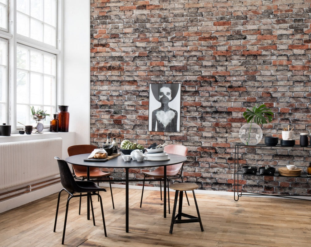 Exposed brick wallpaper by Rebel Walls used in a warehouse dining room setting