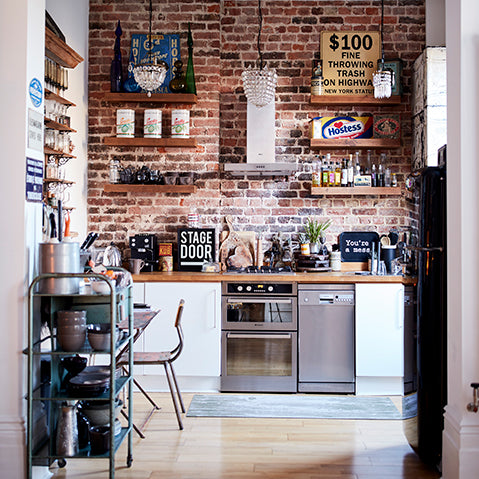 industrial kitchen scheme with exposed brick feature wall