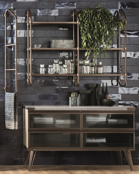 The Stock Rack system features shelves with an aluminium frame, in a bronze-finish, and Smoky Glass surfaces.